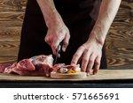 butcher cutting pork meat on... | Shutterstock . vector #571665691