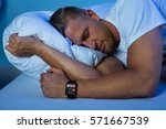 man sleeping with smart watch... | Shutterstock . vector #571667539