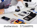 close up of technician hand... | Shutterstock . vector #571668991