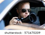 private detective sitting...   Shutterstock . vector #571670209