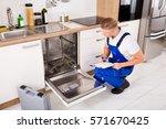 repairman sitting near... | Shutterstock . vector #571670425