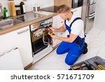 young repairman checking... | Shutterstock . vector #571671709