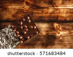 dark chocolate bar in foil on... | Shutterstock . vector #571683484