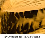 golden sands of the desert.... | Shutterstock . vector #571694065