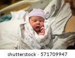 newborn baby in hospital after... | Shutterstock . vector #571709947