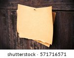 old brown paper on wood board... | Shutterstock . vector #571716571