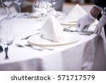 restaurant personnel preparing... | Shutterstock . vector #571717579