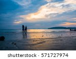 couple lanced past sunset. | Shutterstock . vector #571727974