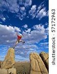 male rock climber leaps across...   Shutterstock . vector #57172963