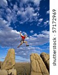 male rock climber leaps across... | Shutterstock . vector #57172969