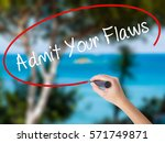 Small photo of Woman Hand Writing Admit Your Flaws with black marker on visual screen. Isolated on nature. Business concept. Stock Photo