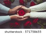 Stock photo love and family concept male and female hands with red roses 571758655