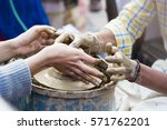 a potter giving pottery making... | Shutterstock . vector #571762201
