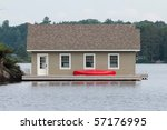 Boathouse with a red canoe - stock photo