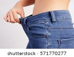Woman Showing Loose Jeans  Los...