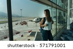 girl at the airport window.... | Shutterstock . vector #571791001