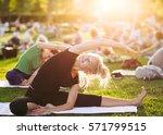 yoga woman on green grass. | Shutterstock . vector #571799515