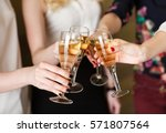 hands holding the glasses of... | Shutterstock . vector #571807564