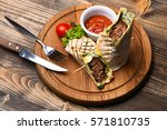 delicious tasty pita with meat... | Shutterstock . vector #571810735