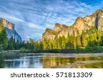 Granite Cliffs Reflecting In...
