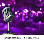 vintage microphone with blurred ... | Shutterstock . vector #571817911