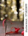 heart shape ribbon in front of... | Shutterstock . vector #571820899