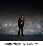 Businessman Standing Over Night City - Fine Art prints