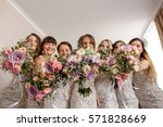 bride and bridesmaids holding... | Shutterstock . vector #571828669
