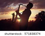 saxophone player or saxophonist ... | Shutterstock . vector #571838374
