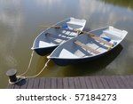 Two Boats With Oars In The...