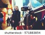 smiling blonde female shopper... | Shutterstock . vector #571883854