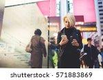 attractive female traveller... | Shutterstock . vector #571883869