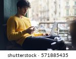 handsome hipster guy monitoring ... | Shutterstock . vector #571885435
