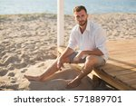 the man in the white shirt and... | Shutterstock . vector #571889701