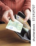 woman is paying with a one... | Shutterstock . vector #571919707