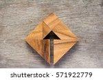 tangram puzzle as arrow in... | Shutterstock . vector #571922779