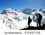 silhouette of skiers high in... | Shutterstock . vector #571937719