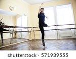 girl exercising on the rhythmic ...   Shutterstock . vector #571939555
