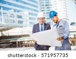 asian engineer and worker with... | Shutterstock . vector #571957735