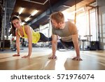 female and male doing exercises ... | Shutterstock . vector #571976074