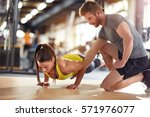 sportswoman train with coaches... | Shutterstock . vector #571976077