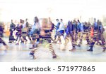 silhouettes of walking people.... | Shutterstock . vector #571977865