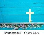 wood cross hanging on antique... | Shutterstock . vector #571983271