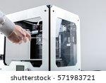 designer working with 3d printer | Shutterstock . vector #571983721