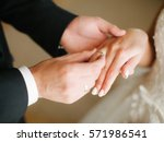 Groom Wears Ring On Bride's ...