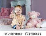 portrait of a cute 8 months... | Shutterstock . vector #571986691
