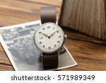 wristwatch near old book and...