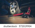 auto service. car tire... | Shutterstock . vector #572019904