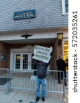 Small photo of MASSAPEQUA PARK, NY - FEBRUARY 3: An unidentified man hold a sign admonishing Rep. Peter King and the Travel Ban at a protest march outside of King's office on February 3, 2017 in Massapequa Park.