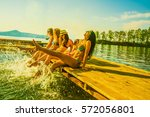 group of happy young woman feet ... | Shutterstock . vector #572056801